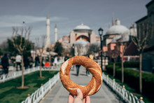 Woman Holding Pretzel In Front...