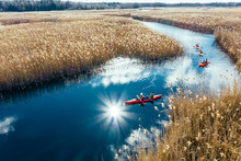 Group Of People In Kayaks Amon...