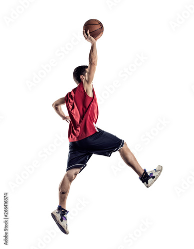 obraz lub plakat Basketball player in action isolated on white background