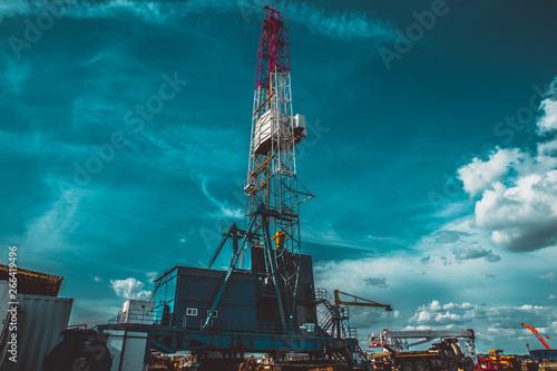 Land oil drilling rig blue sky