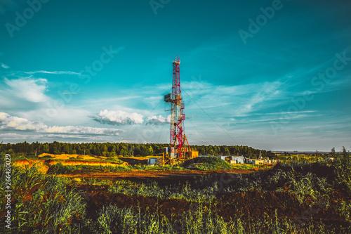 Fototapeta Land oil drilling rig blue sky obraz