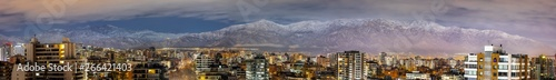 Photo  Amazing views of Santiago de Chile skyline by night with the Andes mountain rang