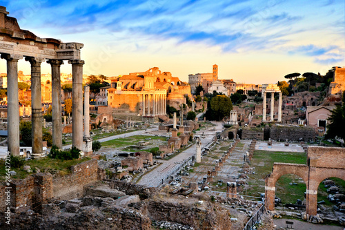 Cuadros en Lienzo View over the ancient Roman Forum at sunset with orange and blue skies, Rome, It