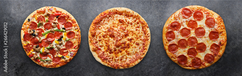 Photo three different pizzas in panoramic composition