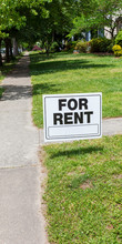 FOR RENT Sign Posted In Lawn A...