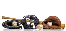 A Group Of Vintage Baseball Equipment On A White Background