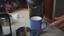 SLOWMO - Pouring Fresh Black Coffee From French Press Into Blue Ceramic Cup