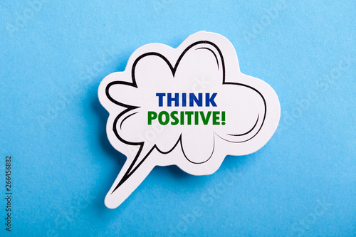 Think Positive Speech Bubble Isolated On Blue Background Canvas Print