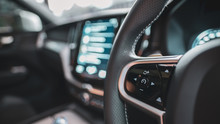 Car Steering Wheel Blurred Bac...