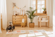 Chalet Baby Bedroom Interior With Cozy Cradle Bed. Light Brown Childish Room With Wooden Empty Cot. Cosy Home Hygge Style Design. Beautiful Child Toy In Large Cottage Background. Modern Eco House
