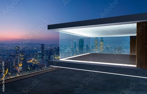 Empty glass wall balcony with city skyline view . Night scene .Mixed media .