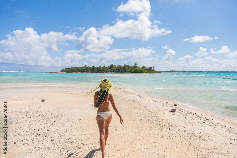 Fototapeta Beach paradise bikini woman enjoying tropical getaway vacation in Rangiroa atoll, Tuamotu islands, French Polynesia.