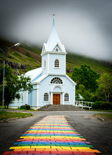 White Church With Rainbow Path In Iceland
