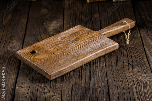 Leinwand Poster Russia, rustic old vintage wooden cutting board for the kitchen, with a groove s