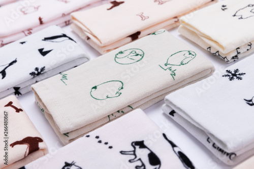 Fotografía Handkerchief depicting an animal's pattern tiled on a white background