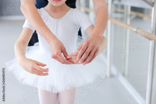 Ballet teacher and little ballerina in classical dancing school Canvas Print