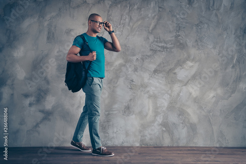 Fototapety, obrazy: Full length side profile body size photo amazing he him his dark skin macho handsome motion go classes lessons carry rear bag wear specs casual blue t-shirt pants shoes isolated grey background