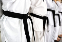 Close Up Of Lined Up Black Belts