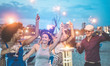 canvas print picture - Happy friends making evening beach party outdoor with fireworks - Young people having fun dancing and drinking champagne - Soft focus on center woman hand - Vacation and nightlife concept
