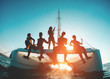 canvas print picture - Silhouette of young friends chilling in catamaran boat - Group of people making tour ocean trip - Travel, summer, friendship, tropical concept - Focus on two left guys - Water on camera