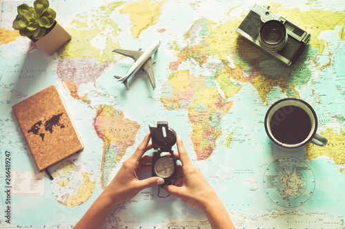 Fototapeta Young woman drinking coffee and planning world tour with vintage travel map - Backpacker girl looking for a new countries to explore - Journey trends, globetrotter and holiday concept - Focus on mug obraz
