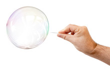 Soap Bubble And A Males Hand With Needle To Let It Pop