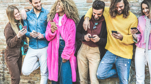 Obraz na plátně  Trendy friends using smartphones - Millennials generation addiction to new techn