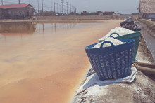 Close Up White Salt In Plastic Basket For Water Evaporation Place On Edge Of Salt Lake At Countryside Of Thailand.