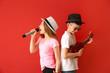 Leinwandbild Motiv Little musicians playing against color background