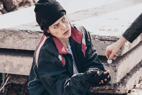Fényképezés  Passer-by giving money to poor homeless woman outdoors