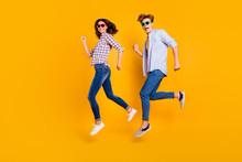 Close Up Full Length Body Size Side Profile Photo Of Pair In Summer Specs He Him His She Her Lady Boy Jumping High Fooling Around Wearing Casual Plaid Shirt Outfit Isolated On Yellow Background