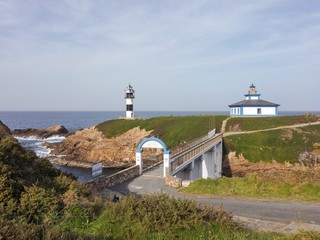 Fototapeta na wymiar Old and new lighthouse on Isla Pancha, Ribadeo, Lugo, Spain.