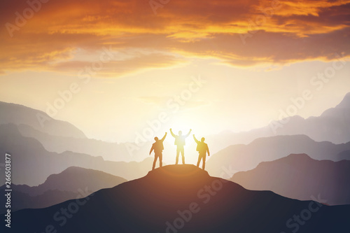 фотография Silhouette of the team on the mountain