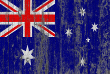 Flag Of Australia Painted On Worn Out Wooden Texture Background.
