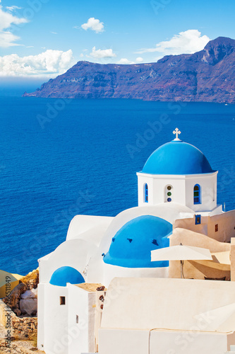 Beautiful Santorini landscape with white church, caldera, sea and sky clouds Wallpaper Mural