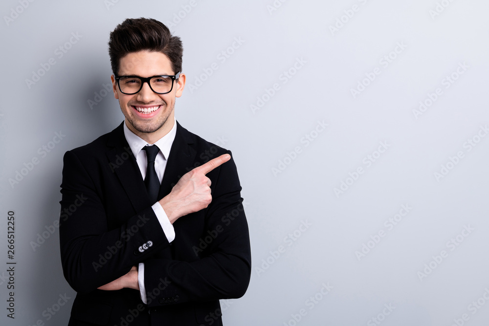 Fototapeta Portrait of his he nice imposing representative elegant classy chic attractive cheerful guy sales expert development agent broker pointing aside isolated over light gray background