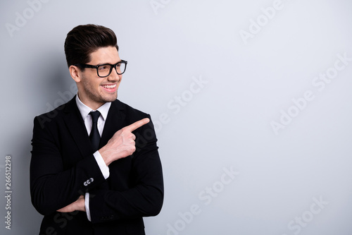Fototapeta Portrait of his he nice imposing elegant classy attractive cheerful positive guy executive leader expert development agent broker pointing aside new novelty isolated over light gray background obraz