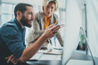Leinwandbild Motiv Business startup concept.Young man working together with partner in modern office loft
