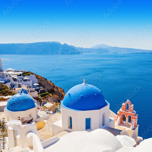 Fototapeta Oia village, Greece landmark. Church of Santorini and white houses obraz