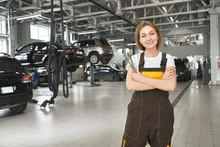 Female Worker Of Autoservice Posing, Smiling.