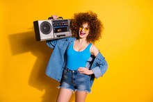 Close Up Photo Beautiful She Her Lady Wavy Fluffy Styling Curls Hands Old-fashioned Tape Recorder Wear Casual Jeans Denim Shirt Shorts Blue Tank Top Outfit Clothes Isolated Yellow Bright Background