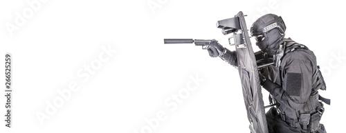 Valokuva  SWAT fighter hiding behind ballistic shield on white