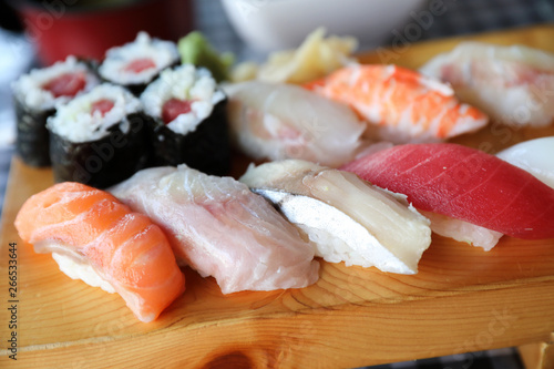Sushi Set nigiri and sushi maki with tea served on wood and soup , Japanese food Canvas Print