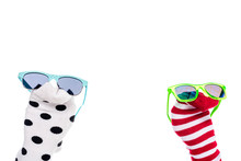 Cropped View Of Person With Colorful Sock Puppets And Sunglasses On Hands Isolated On White