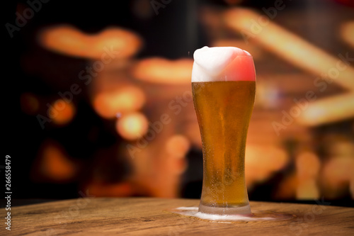 Canvas Prints Beer / Cider Beer glass in front of blurred background
