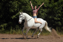 Young Woman Enjoy Riding Bareback On A Galloping White Horse