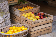 Choice Of Fresh Ripe Fruit In Wooden Boxes In A Market