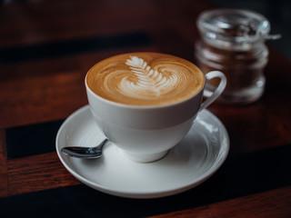 coffee latte art in cafe wi...