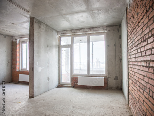 Tuinposter Industrial geb. Concrete and brick walls in the apartment for repair
