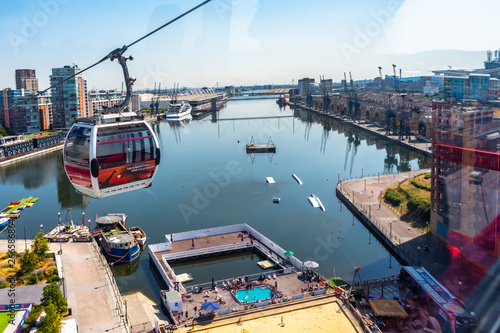 Fotografie, Obraz  Emirates Air Line cable cars on thames river in London, UK